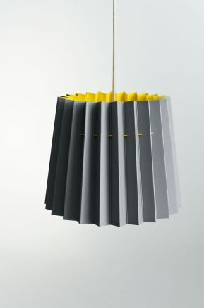 LANE TWIN TONE LAMPSHADE – SMOKE GREY & FACTORY YELLOW  A pendant lampshade with a simple, beautiful and clean aesthetic. The Twin Tone Lampshade is made entirely from one single material – two sheets of heavyweight paper that are bonded together to show one colour on the inside and another on the outside.  There are no plastic components, making it entirely recyclable and biodegradable.  Size:  Height: 30cm Diameter (top): 30cm Diameter (bottom): 45cm approx  £65