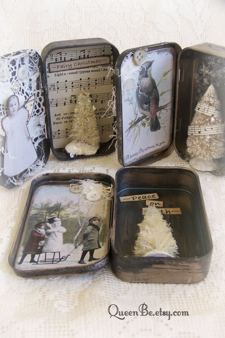 Adorable tarnished and aged Altoid tin, made into a miniature Christmas wonderland/shadow box! A perfect little shelf sitter, the miniature little snowy world has a white glittered bottle brush tree and the words Peace on Earth on one side, and a vintage image of children in snow, tattered lace and a white button on the other side. The front has been adorned with tattered lace and more white buttons. Measures 3 3/4 by 4 3/4 inches when opened. So charming! The last photo shows a collection…