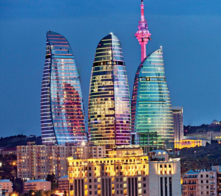 Flame Towers is the tallest skyscraper in Baku, Azerbaijan with a height of 620 ft. The buildings consist of apartments, a hotel and office blocks. Construction began in 2007, with completion in 2012. HOK was the architect for the project, DIA Holdings served as the design-build contractor, and Hill International provided project management. The facades of the three Flame Towers are turned into gigantic display screens with the use of more than 10,000 high-power LED luminaire.