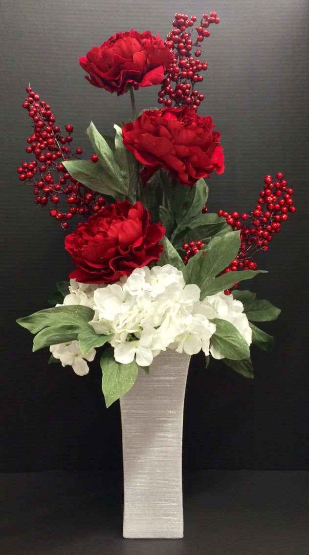 Winter 2014 Season faux floral: Red Peonies, white Hydrangeas, berry picks on glitter silver tall urn vase. Original design and arrangement by http://nfmdesign.synthasite.com/