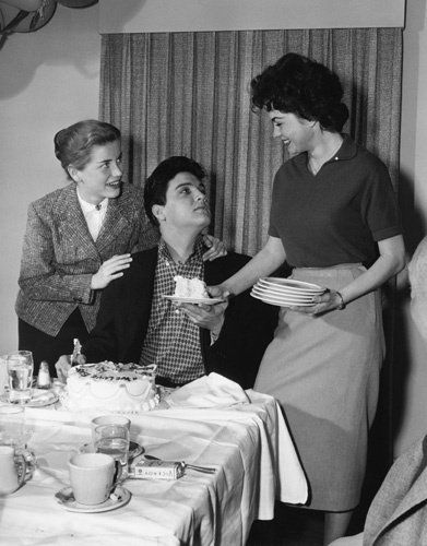 Elvis Presley with Dolores Hart and Valerie Allen at an Army Bond farewell party given by Hal Wallis during the making of king creole