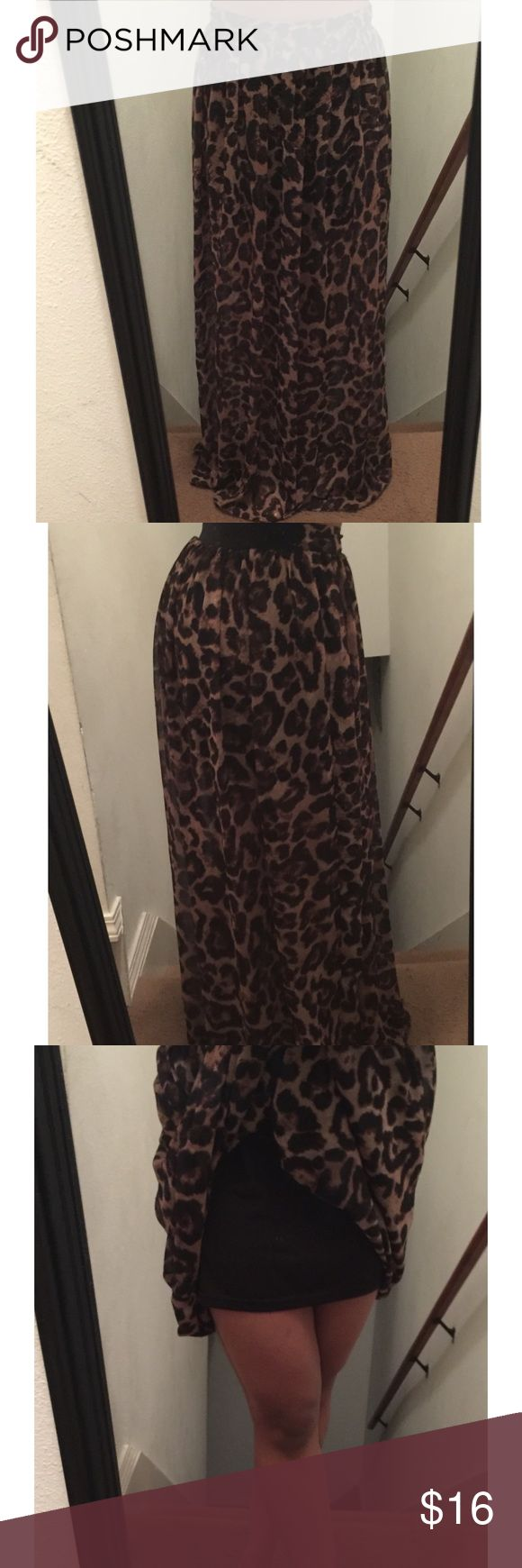 Long leopard maxi skirt Forever 21 long leopard maxi skirt Attached slip underneath, elastic band on back Size S, Good condition..see photos for measurements Forever 21 Skirts Maxi
