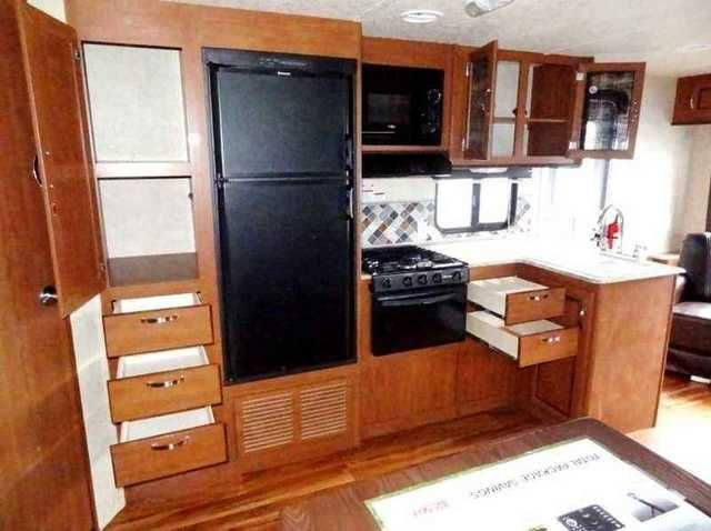 2016 New Forestriver WILDWOOD 254RLXL Travel Trailer in Alabama AL.Recreational Vehicle, rv, The Wildwood X-Lite 254RLXL travel trailer by Forest River offers two entrances, and a rear living area.Look at the option list here! Upgraded Everything!!!! Double Door Refrigerator, Oak Table, Real Wood Cabinets, Remote Control - Slide, Stabilizer Jacks, Awning, Tongue Jack, Cable Ready, Skylight, Ducted Heat and Air Conditioning, Upgraded Flooring, On and On...Stepping inside the rear entrance…