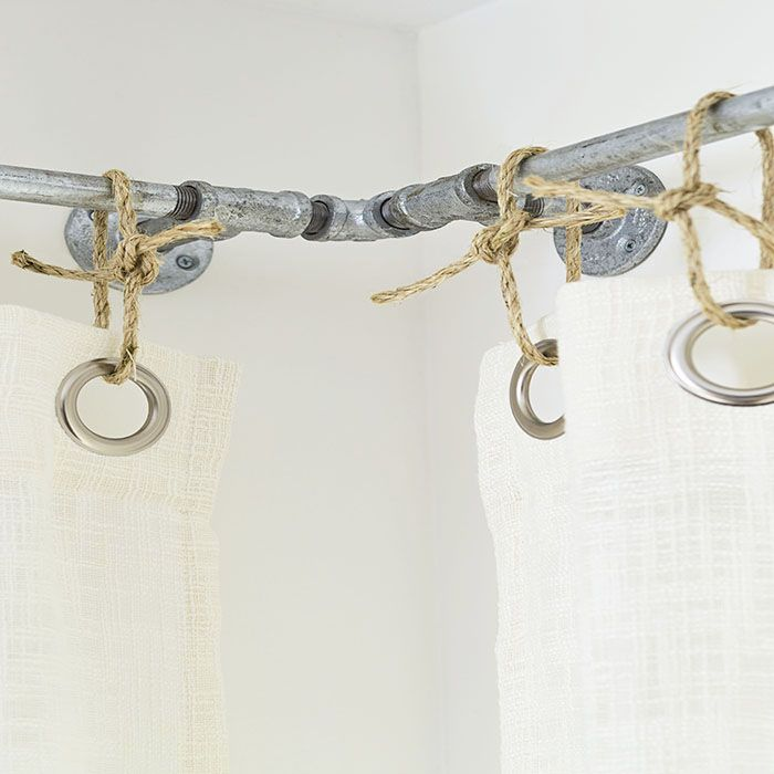 DIY Corner Window Curtain Rods Made From Threaded Pipe And Fittings Paired  With Sisal Grommet Ties