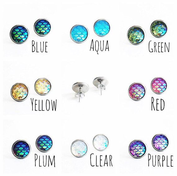 These adorable mermaid stud earrings are great for any mermaid or mermaid in training! Posts/Settings: hypoallergenic surgical steel (the BEST for sensitive ears). Scales are made from resin. Size: 10mm round  Colors: Please choose the pair you wish to purchase from the drop down box (see pic for color reference).  Other: these earrings have an iridescent finish perfect for catching light and are textured to feel like the scales on a mermaids tail. Packaging: all of our earrings are…