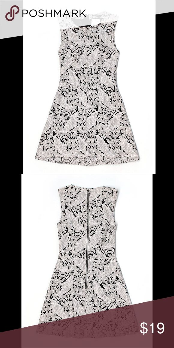 "NWT $39 H&M Ivory Printed Sleeveless Dress sz 2 New with tags $39 HM casual mini dress size 2 / small. Ivory / white in color, Sleeveless, crew neckline, black printed accents. 26"" chest 32"" length. 62% cotton 38% Polyester H&M Dresses Mini"