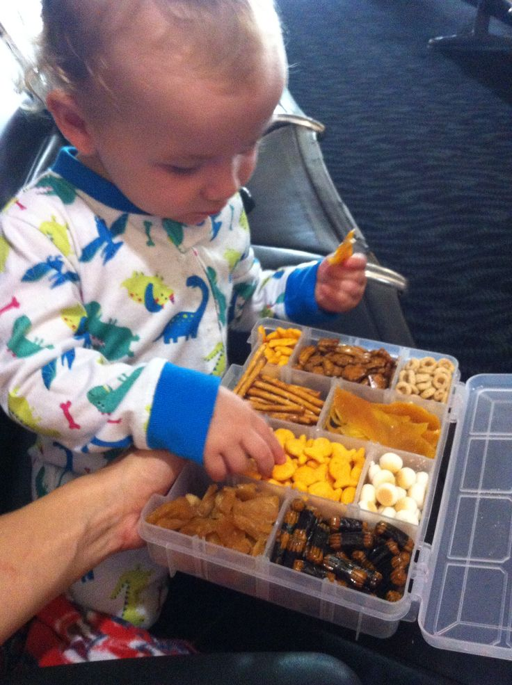 Traveling with toddlers?! Make your own Snackle Box using a cheap tackle box! Just add your favorite snacks!