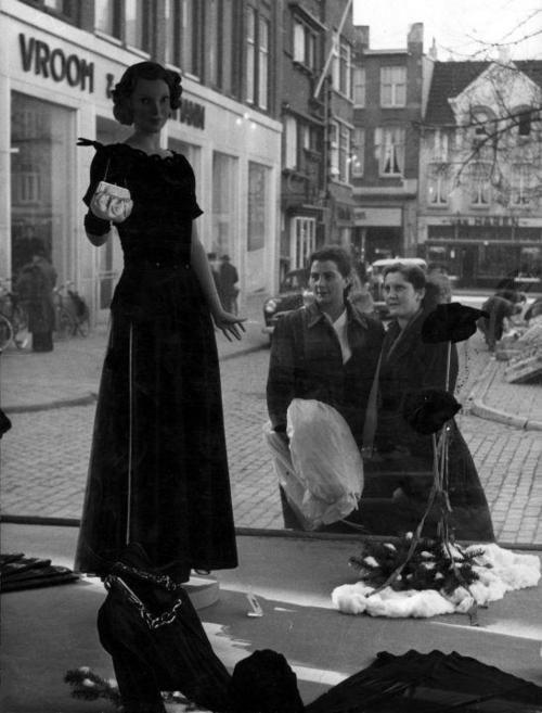 Two women window shopping in Heerlen, The Netherlands, 1949.