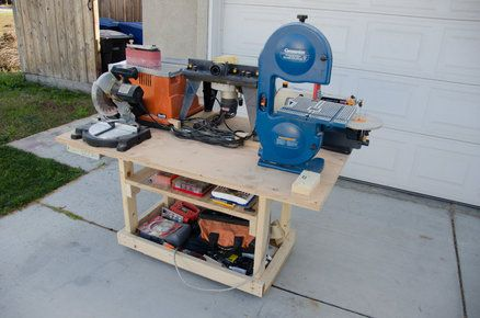 Mobile Power Tool Station by Fridgecritter -- Homemade mobile power tool station intended to accommodate multiple benchtop power tools. Beneath the cart are provisions for an electrical power strip and a vacuum/separator unit. Constructed from surplus plywood. http://www.homemadetools.net/homemade-mobile-power-tool-station