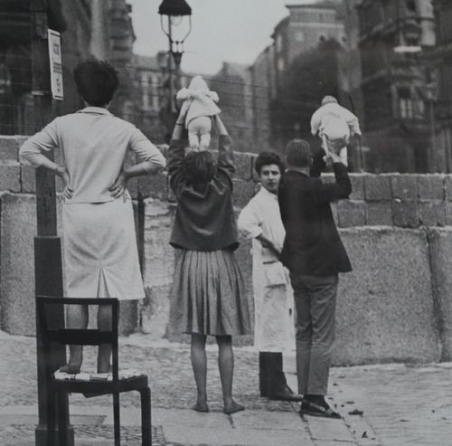 Germany: West Berliners show children to their grandparents who reside on the Eastern side, 1961