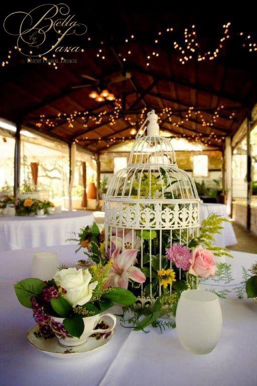 Gorgeous garden theme wedding with vintage birdcage