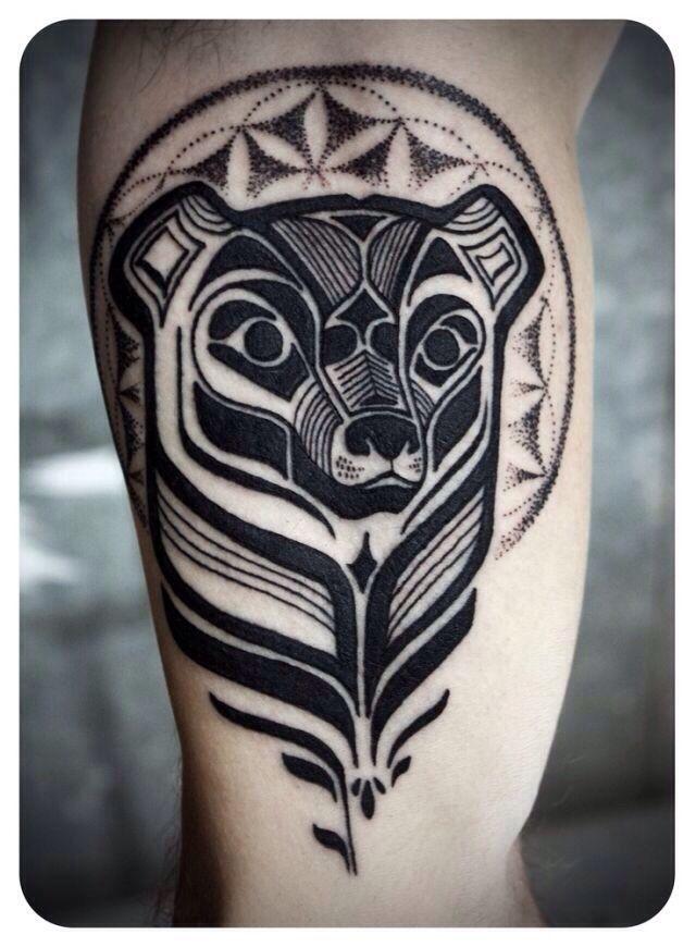 http://tattoomagz.com/david-hale-tattoos/david-hale-tattoo-bear-head-with-halo/