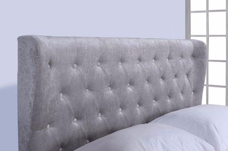 Flair Furnishings New-Rebecca Fabric Ottoman Silver Superking The Lola Fabric Bed Frame consists of a modern, sleigh style design with a cushioned and buttoned headboard which gives the bed frame a luxurious feel.