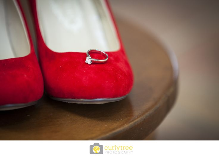 Engagement ring on a cute red shoe:)