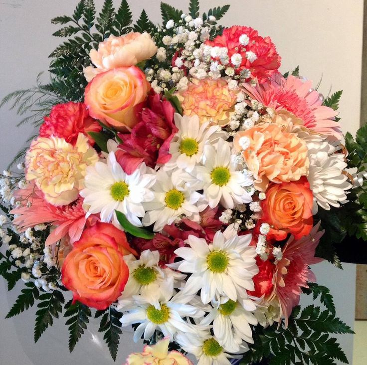 Peach white and pink floral bouquet. with Roses, Daisies, gerbera, carnations and babies breath.