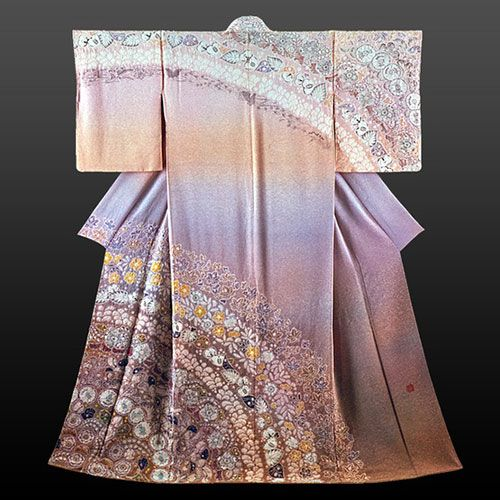 KIMONO, the symbol of beauty in Japan, is a Japanese traditional garment worn by men, women and children. Today, kimono are most often worn by women, and on special occasions. Traditionally, unmarried women wore a style of kimono called furisode, that is the most common type, with almost floor-length sleeves. It is now worn at coming-of-age ceremonies, bride at weddings and wedding receptions, and married women wear a kimono called TOMESODE......SOURCE TOKYOPIC.COM......