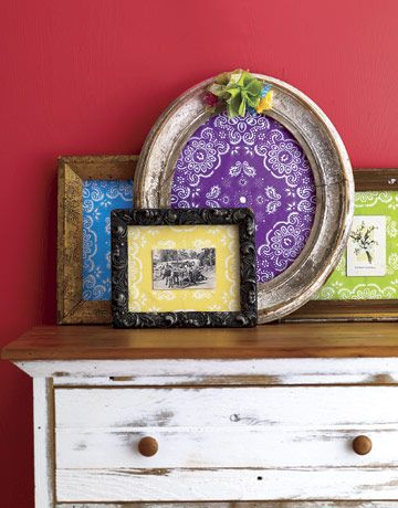 Framed Bandannas  Shop flea markets for inexpensive vintage wooden frames missing their backs, which are ideal for this project. Paint each one differently, then group into an eye-catching collection.    1. Trace each frame's opening onto white foamboard, then cut so it fits snugly inside the frame.     2. Stretch a bandanna over the foamboard. If excess fabric is too bulky, trim, leaving 2 inches remaining.     3. Neatly fold the remaining fabric against the back of the foamboard and hot…
