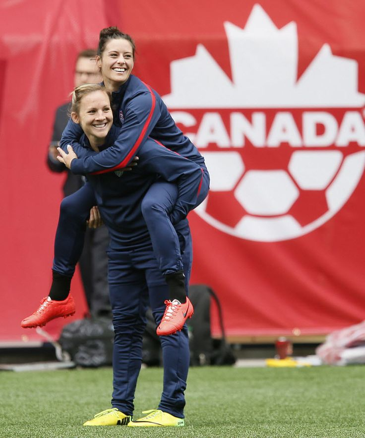 Amy Rodriguez and Ali Krieger during training in Winnipeg, May 7, 2014. John Woods/The Canadian Press/AP)