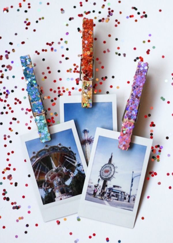 DIY Glittered Clothespins To Hold Your Fancy Photos - love the idea! They use a thumbtack on the back for a cork board but I would use a magnet for the fridge