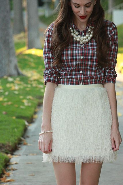 Holiday outfit: plaid shirt and feathery skirt with chunky pearl necklace