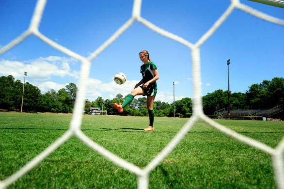 This single shot has an interesting angle and captures the soccer player in action