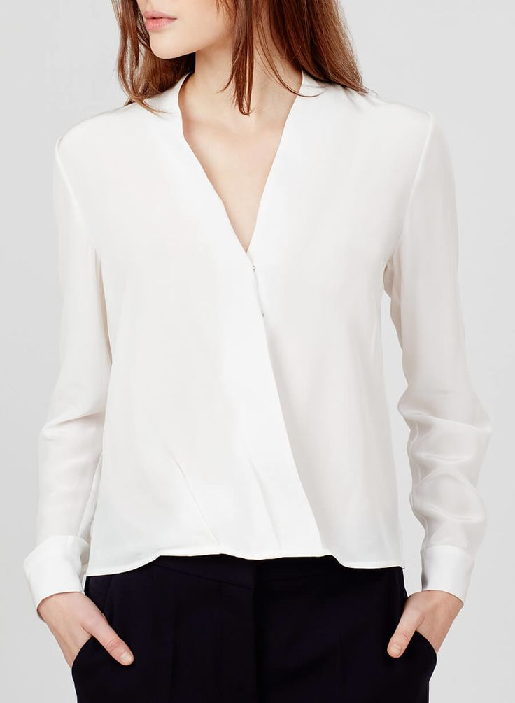 A silk staple that delivers elegance and ease to your closet essentials, our wrap blouse is crafted in the United States from sleek silk crepe de chine. Its flattering V-neckline and back box-pleat ensure an easy fit. This piece can be elevated for evening with leather pants or styled for day with tailored trousers or sleek skirts.