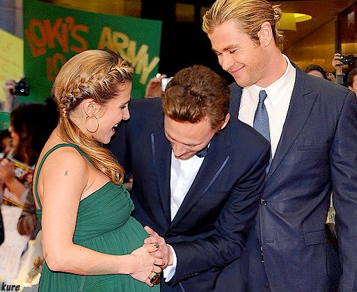 Tom and Chris with Chris' wife. Tom looks so excited for them and Chris looks so proud.