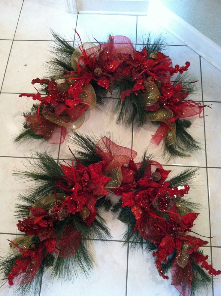 Christmas Swags for door frames, mirror, bookshelf, mantel....possibilities are endless. By Greatwood Floral Designs.