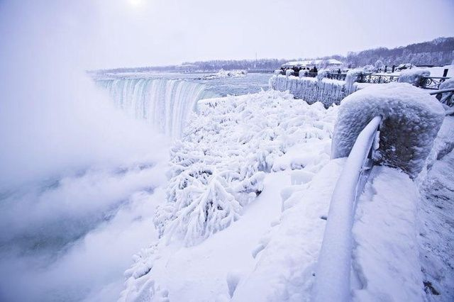 Niagara Falls freezes after wind chill factor drops temperature to -67°C DEGREES across USA ahead of New Year's Eve