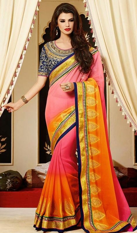 With florence, glam-chic looks are never hard to do as you don this orange and pink shade faux georgette sari. This stunning attire is displaying some astounding embroidery done with lace and stones work.  #AlluringGeorgetteDesignerSari