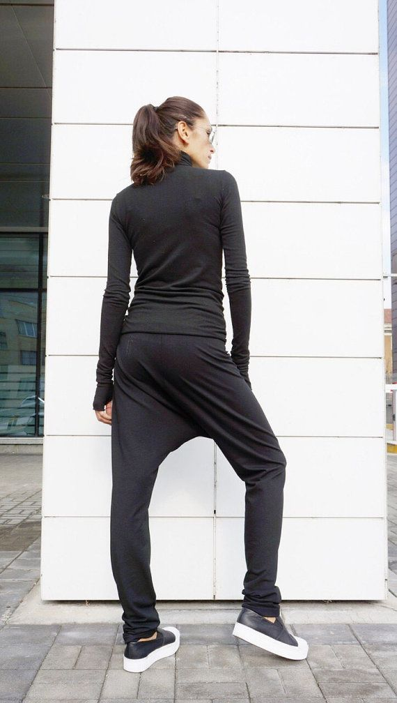 This gorgeous comfortable black drop crotch pants will be your Must have  garment for the new season... Asymmetrical Front long zipper ,side pockets , adjustable waistline ,both high and low wasted ... So comfy and easy to wear at the same time a touch of elegance and style... Wear it with extravagant tunic,sneakers, favorite tee or top,or hoodie or sweater....or what else do you have in mind will be always just PERFECT....  Size ( XS,S,M,L,XL,XXL,XXXL,4XL... ) Fabric cotton and lycra   Size…