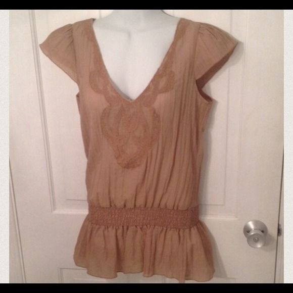 Charlotte Russe tan with flutter sleeve top Charlotte Ruuse tan top with flutter sleeves.  Has V neck and elastic gather around waist. Has embroidered design around neck line.  In mint condition. Charlotte Russe Tops