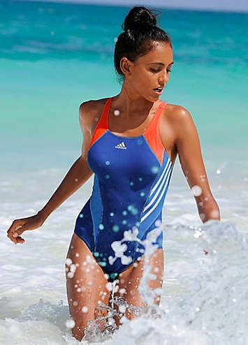 Style and sport come together in this racerback and chlorine-resistant 'Infinitex' fabric swimsuit. The orange straps beautifully compliment the blue base colour to give a look of feminine power. The classic stripes and brand logo are classically placed allowing this bikini to take you from water polo to beach volleyball. adidas Performance Swimsuit Features: Colour: Blue Washable Lining: 100% Polyester 80% Polyamide, 20% Elastane (Xtra Life Lycra*) *Lycra is a registered trademark of In...