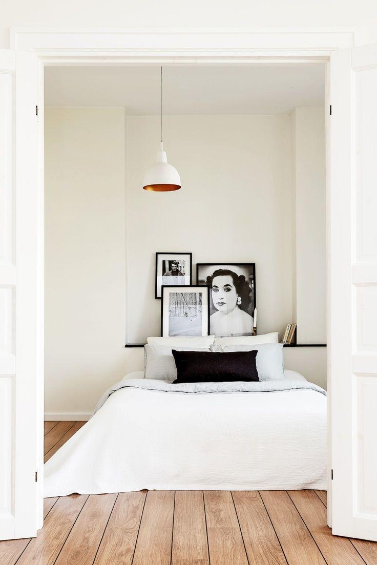 Black and white bedroom via Erik Olsson Fastigheter.