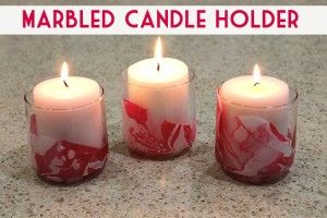 Great fun! Make these marbled Valentine candle holders using red and white fingernail polish!