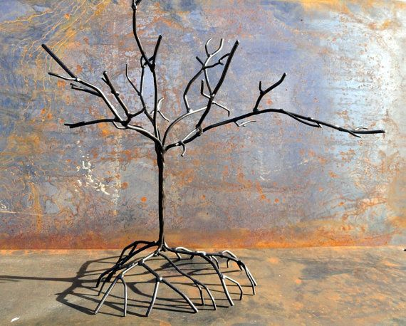 Welded metal tree sculpture from StevensGarage shop on etsy. Would be a cool way to display jewelry