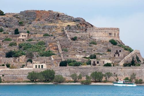 Spinalonga, Crete    Eerie ruins, pirate legends, beaches, and a boat trip across the Gulf of Mirabello make this little island a hit with young travelers. As the boat passes the nearby islet of Agios Pantes, tell them to keep an eye out for the agrimi, also known as the kri-kri -- a species of long-horned wild goat endemic to Crete.    Photo Caption: Spinalonga has long been a place of refuge, most recently for lepers. Crete, Greece.    Photo by Georgios Makkas