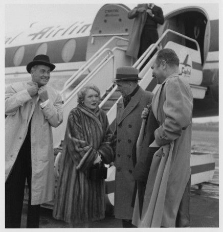 """Pickford and husband Charles """"Buddy"""" Rogers are greeted at the Rochester airport by Oscar Solbert and James Card"""