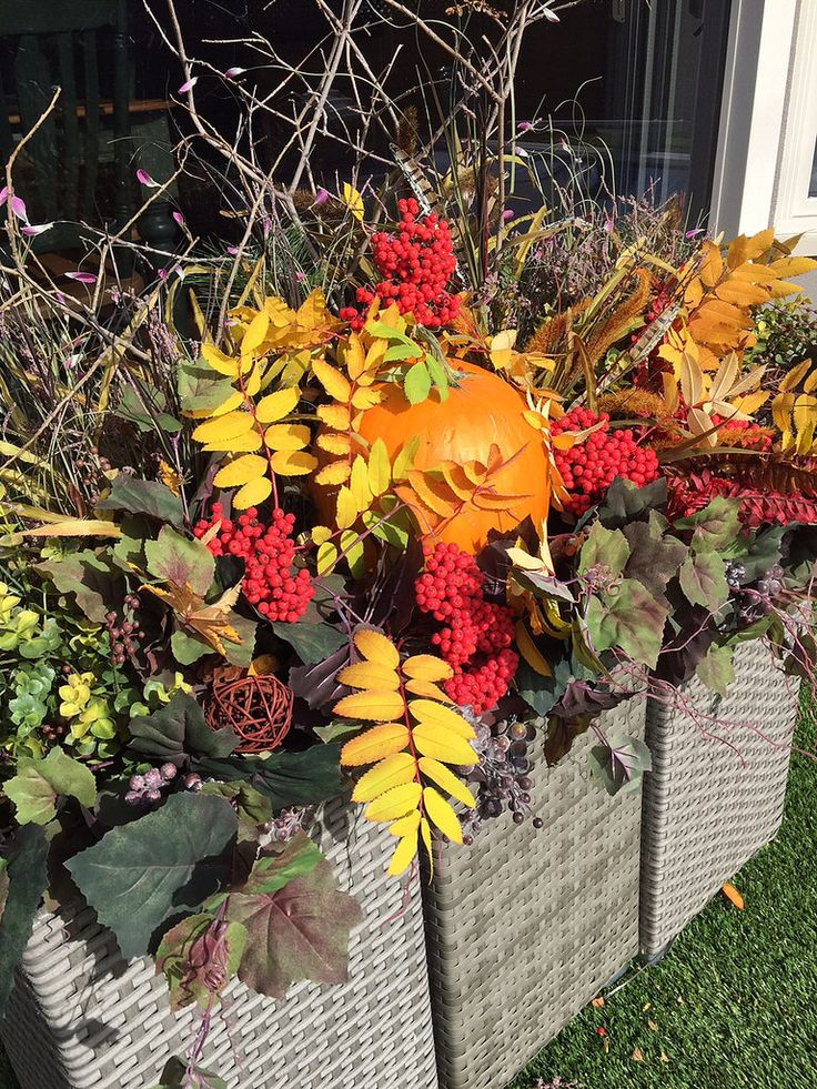outdoor summer planters filled with Autumn Harvest arrangment