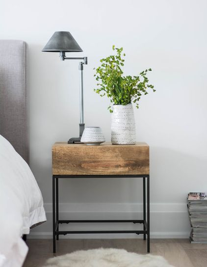 Bed, nightstand: West Elm; pottery: Target; table lamp: Restoration Hardware