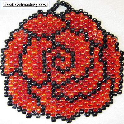 Peyote Rose Pendant, This Beaded Peyote Rose Pendant was created using red, orange and black Japanese seed beads, adopting the Peyote beading technique.