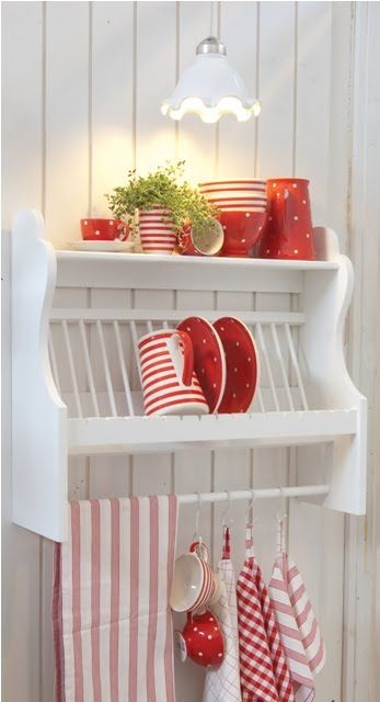 My kitchen theme will be red and white/cream with a hint of coastal blue like this!