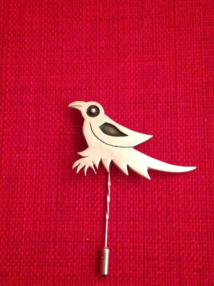 Bird brooch made by Helen Green from silver sheet with oxidised detail.