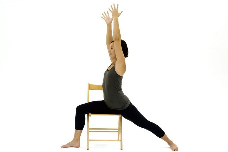 10 Yoga Poses You Can Do in a Chair: Chair Warrior I - Virabhadrasana I