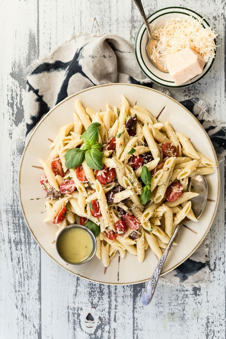 Delicious Roasted Garlic Pomodoro Pasta Salad. This is the salad you want to take to every summer party you go to! It'll be first gone and everyone will be asking you about it. #pasta #pastasalad #pomodoropasta #Italianrecipes