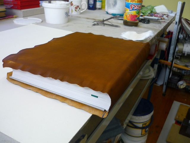 Fig 11 Leather being fitted to the book block