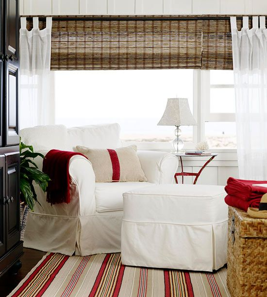 BHG beach house with red accents-white slipcovered chair