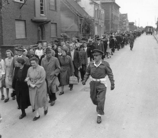 Burgsteindorf, Germany, German citizens marched to the local cinema to watch films documenting the horrors of the camps, 30/05/1945. The conquering forces of the British army forced the local population to watch films about the horrors commited by the Nazi government. At the same day, around 4000 residents of the village Burgsteindorf were forced to watch a movie containing scenes from the liberation of Bergen-Belsen and Buchenwald