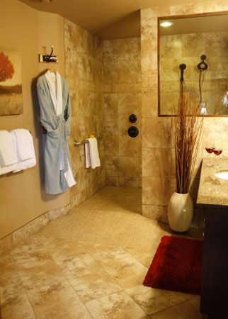 the luxury bathroom complete with walk in multiple head shower heated floors and stone tiles in the stalbes suite
