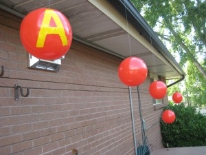 Beach ball decorations will get your guests excited for the outdoor showing of Alvin and the Chipmunks - Southern Outdoor Cinema expert tip for theming and enhancing an outdoor movie event.